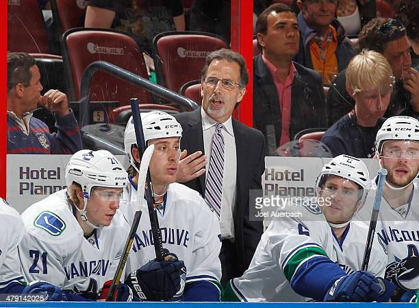 Head coach John Tortorella of the Vancouver Canucks gestures towards the referee after a penalty call against the Florida Panthers at the BBT Center...