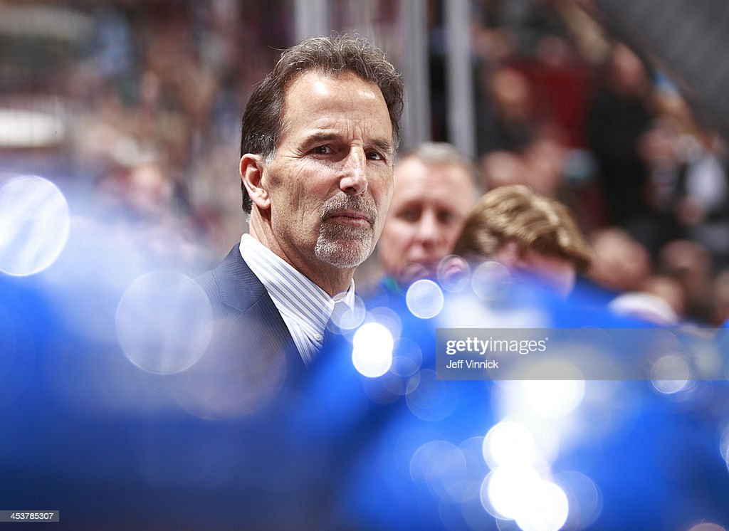 Head coach <a gi-track='captionPersonalityLinkClicked' href=/galleries/search?phrase=John+Tortorella&family=editorial&specificpeople=213393 ng-click='$event.stopPropagation()'>John Tortorella</a> of the Vancouver Canucks looks on from the bench during the NHL game against the Florida Panthers at Rogers Arena on November 19, 2013 in Vancouver, British Columbia, Canada.