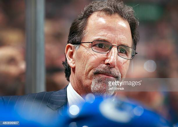 Head coach John Tortorella of the Vancouver Canucks looks on from the bench during their NHL game against the Calgary Flames at Rogers Arena March 8...
