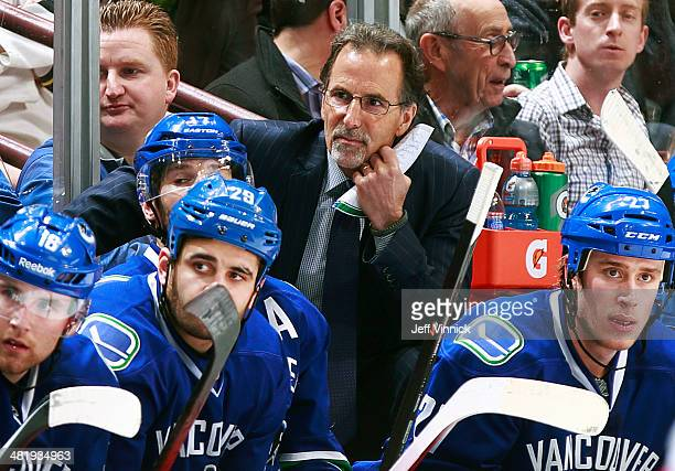 Head coach John Tortorella of the Vancouver Canucks looks on from the bench during their NHL game against the New York Rangers at Rogers Arena April...