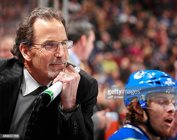 Head coach John Tortorella of the Vancouver Canucks looks on from the bench during their NHL game against the Los Angeles Kings at Rogers Arena April...