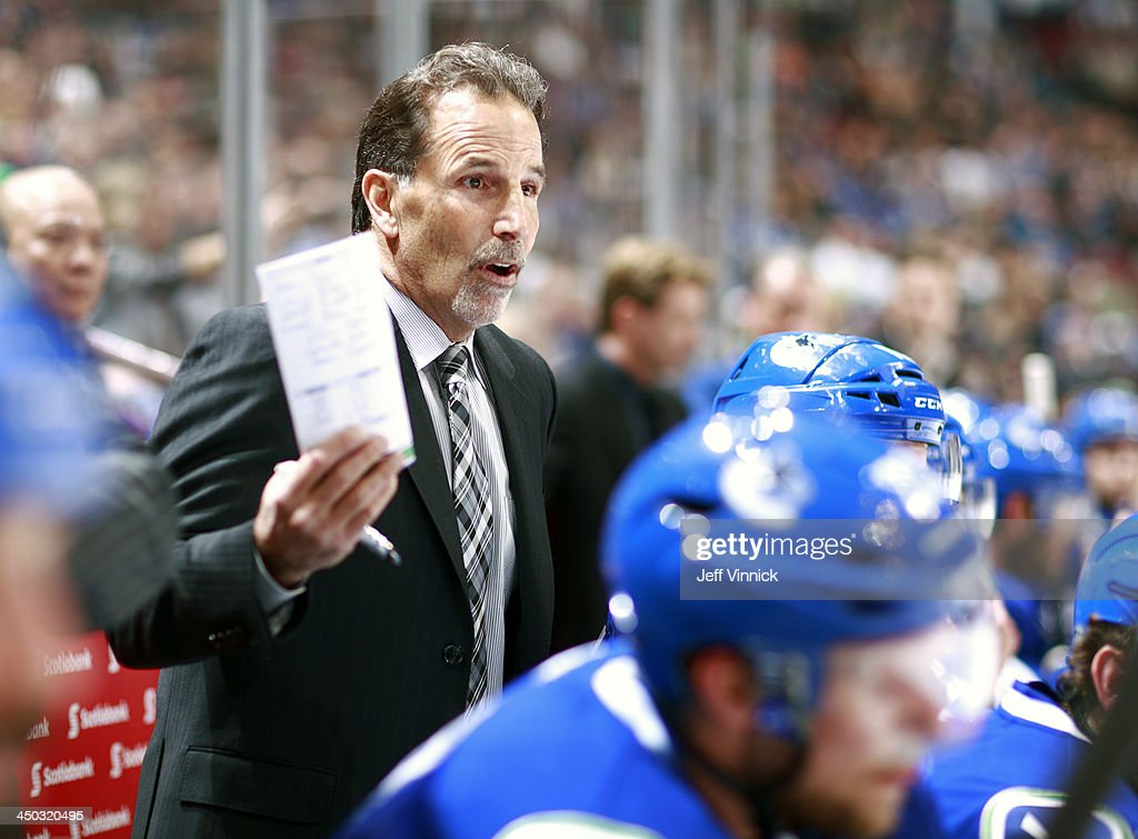 Head coach <a gi-track='captionPersonalityLinkClicked' href=/galleries/search?phrase=John+Tortorella&family=editorial&specificpeople=213393 ng-click='$event.stopPropagation()'>John Tortorella</a> of the Vancouver Canucks protests a disallowed goal during their NHL game against the Dallas Stars at Rogers Arena on November 17, 2013 in Vancouver, British Columbia, Canada. Dallas won 2-1.