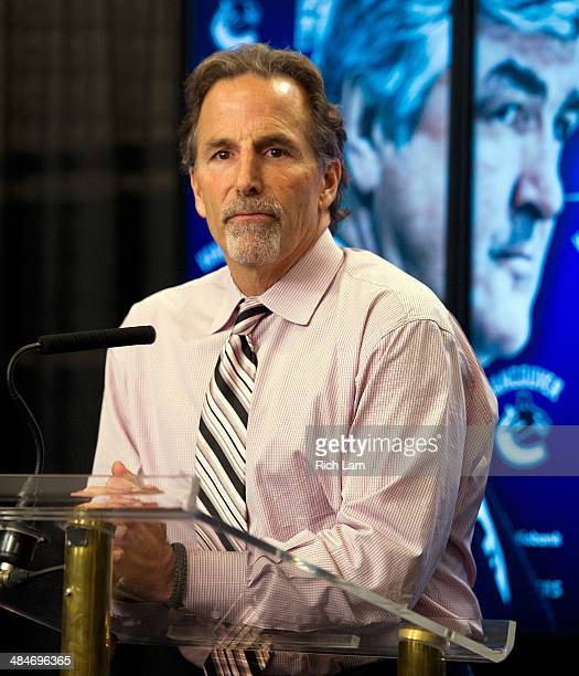 Head coach John Tortorella of the Vancouver Canucks speaks with reporters during the postgame press conference after defeating the Calgary Flames 51...