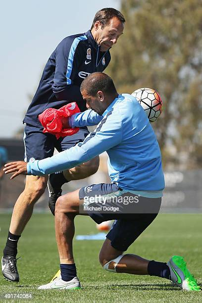 Head Coach John van't Schip and Patrick Kisnorbo of the City compete for the ball during a Melbourne City FC ALeague training session at City...