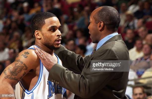 Head Coach Johnny Davis and Jameer Nelson of the Orlando Magic discuss strategy against the Toronto Raptors during a game at TD Waterhouse Centre on...