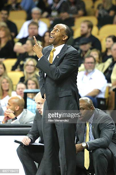 Head coach Johnny Dawkins of the UCF Knights looks at the scoreboard during an NCAA basketball game against the SMU Mustangs at the CFE Arena on...