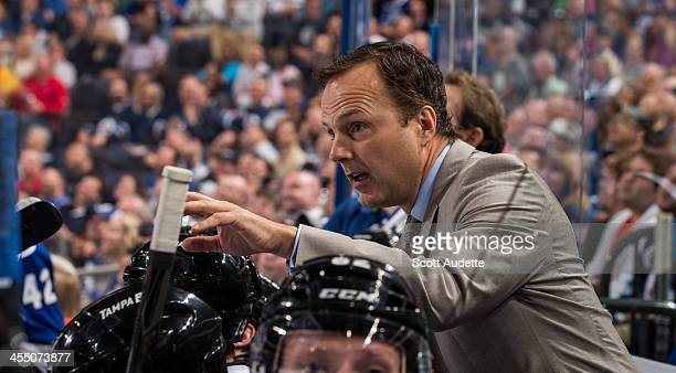 Head coach Jon Cooper of the Tampa Bay discuses strategy with his team during a break against the Winnipeg Jets at the Tampa Bay Times Forum on...