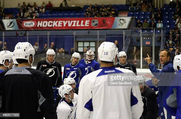 Head coach Jon Cooper of the Tampa Bay Lightning conducts practice for the NHL Kraft Hockeyville USA preseason game against the Pittsburgh Penguins...