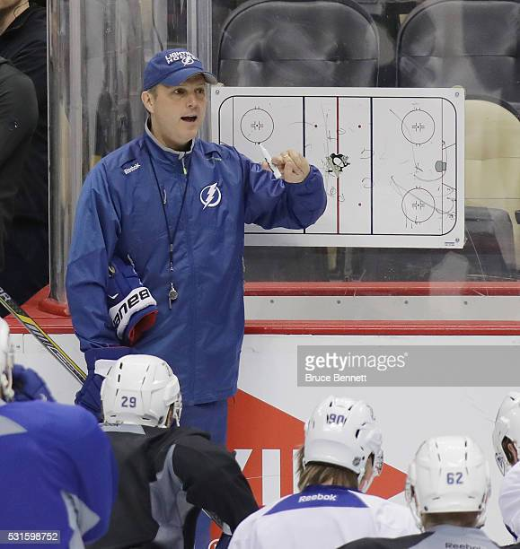 Head coach Jon Cooper of the Tampa Bay Lightning conducts practice during an offday session prior to Game Two of the Eastern Conference Final against...