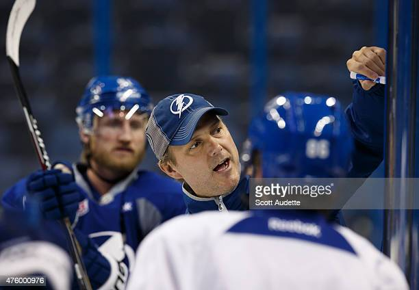 Head coach Jon Cooper of the Tampa Bay Lightning gives instructions to the team during practice at the 2015 NHL Stanley Cup Final at Amalie Arena on...