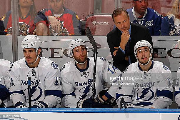 Head Coach Jon Cooper of the Tampa Bay Lightning keeps an eye on the action against the Florida Panthers at the BBT Center on March 1 2015 in Sunrise...