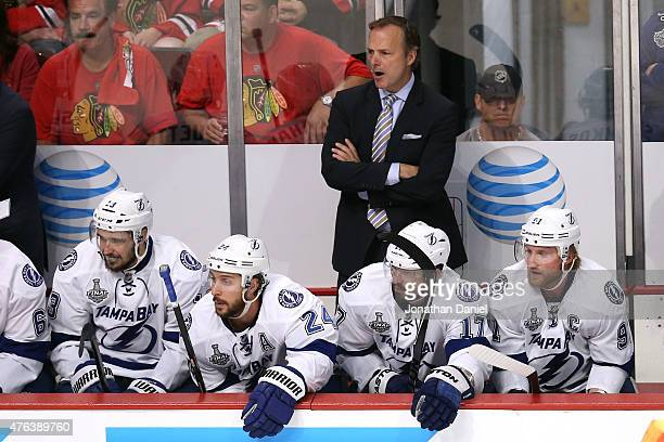 Head coach Jon Cooper of the Tampa Bay Lightning looks on from the bench against the Chicago Blackhawks during Game Three of the 2015 NHL Stanley Cup...