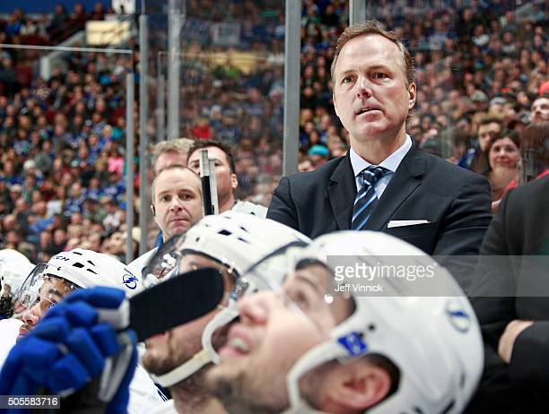 Head coach Jon Cooper of the Tampa Bay Lightning looks on from the bench during their NHL game against the Vancouver Canucks at Rogers Arena January...