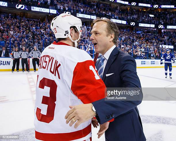 Head Coach Jon Cooper of the Tampa Bay Lightning shakes the hand of Pavel Datsyuk of the Detroit Red Wings after the series win in Game Five of the...