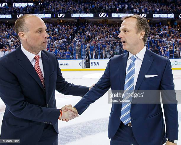 Head Coach Jon Cooper of the Tampa Bay Lightning shakes the hand of Head Coach Jeff Blashill of the Detroit Red Wings after the series win in Game...