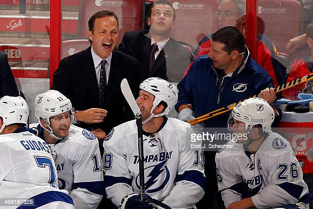 Head Coach Jon Cooper of the Tampa Bay Lightning shares a happy moment with his team during their 61 win against the Florida Panthers at the BBT...