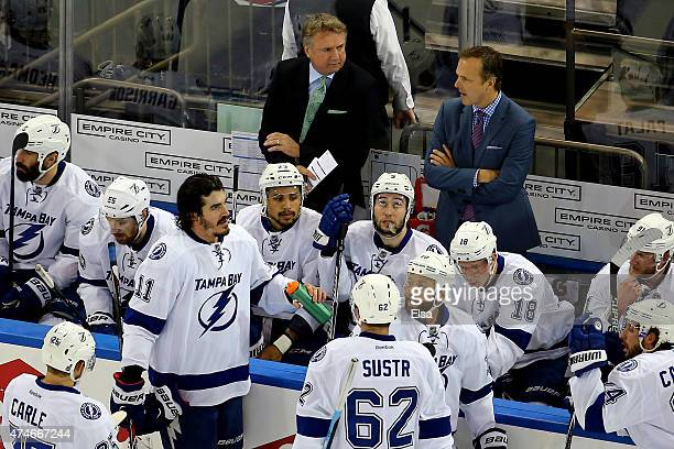Head coach Jon Cooper of the Tampa Bay Lightning speaks to his team during a timeout in the first period against the New York Rangers of Game Five of...