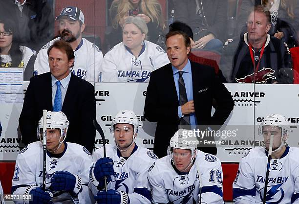 Head coach Jon Cooper of the Tampa Bay Lightning watches from the bench during the NHL game against the Arizona Coyotes at Gila River Arena on...