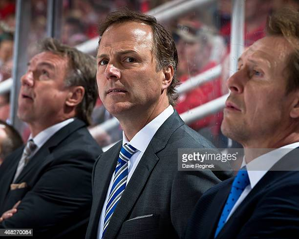 Head coach Jon Cooper of the Tampa Bay Lightning watches the action from the bench during a NHL game against the Detroit Red Wings on March 28 2015...