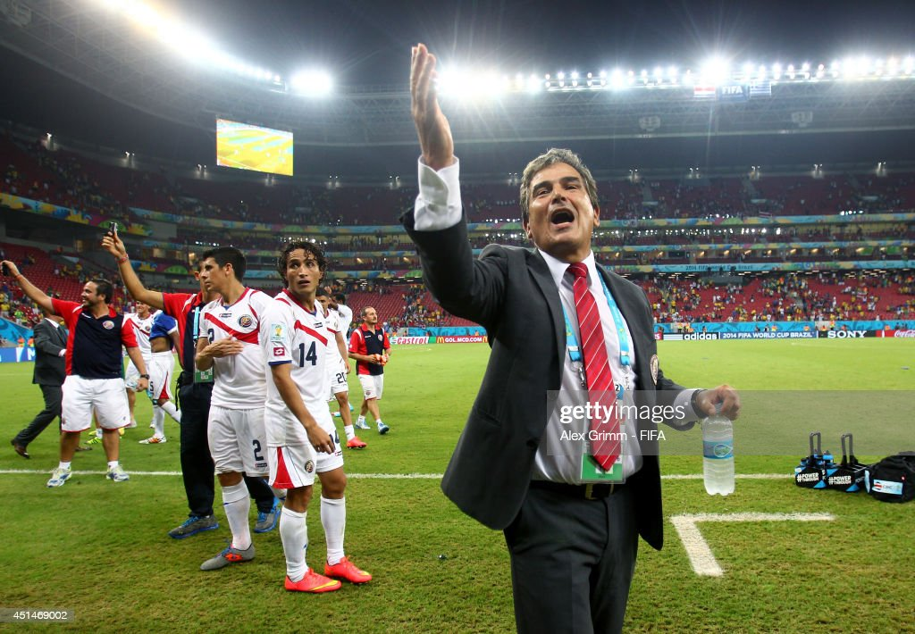 Head coach <a gi-track='captionPersonalityLinkClicked' href=/galleries/search?phrase=Jorge+Luis+Pinto&family=editorial&specificpeople=2548389 ng-click='$event.stopPropagation()'>Jorge Luis Pinto</a> of Costa Rica celebrates victory after the 2014 FIFA World Cup Brazil Round of 16 match between Costa Rica and Greece at Arena Pernambuco on June 29, 2014 in Recife, Brazil.