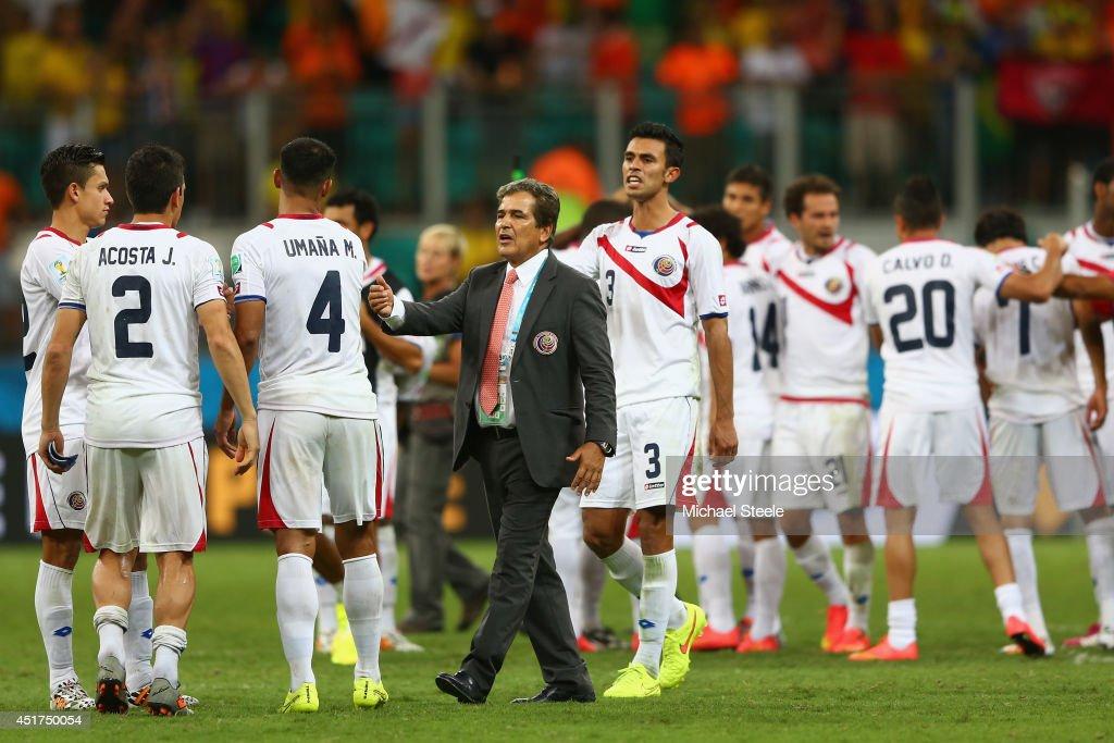 Head coach <a gi-track='captionPersonalityLinkClicked' href=/galleries/search?phrase=Jorge+Luis+Pinto&family=editorial&specificpeople=2548389 ng-click='$event.stopPropagation()'>Jorge Luis Pinto</a> of Costa Rica consoles his players after a defeat to the Netherlands in a penalty shootout during the 2014 FIFA World Cup Brazil Quarter Final match between the Netherlands and Costa Rica at Arena Fonte Nova on July 5, 2014 in Salvador, Brazil.