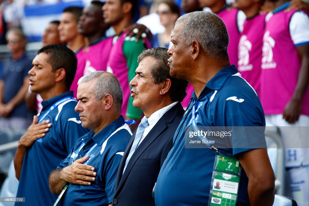 Head coach <a gi-track='captionPersonalityLinkClicked' href=/galleries/search?phrase=Jorge+Luis+Pinto&family=editorial&specificpeople=2548389 ng-click='$event.stopPropagation()'>Jorge Luis Pinto</a> of Honduras sings the national anthem of Honduras prior to the 2015 CONCACAF Gold Cup match against Haiti at Sporting Park on July 13, 2015 in Kansas City, Kansas.