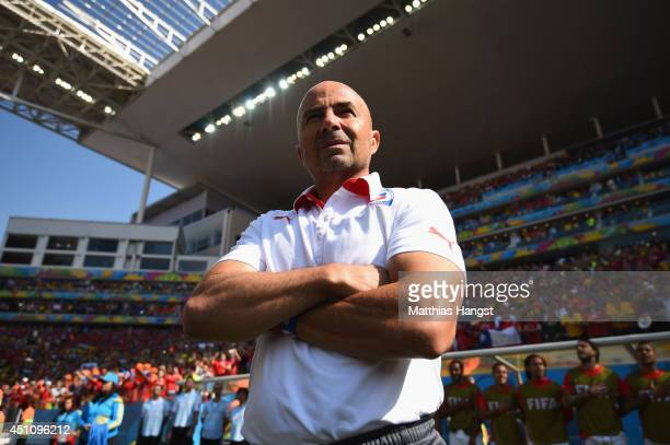 Head coach Jorge Sampaoli of Chile looks on during the 2014 FIFA World Cup Brazil Group B match between the Netherlands and Chile at Arena de Sao...