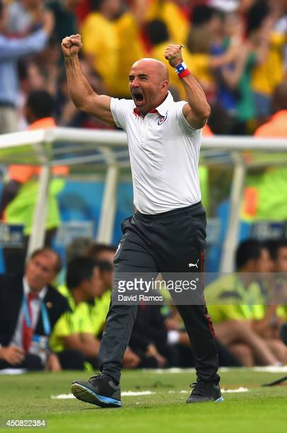 Head coach Jorge Sampaoli of Chile reacts after his team's first goal during the 2014 FIFA World Cup Brazil Group B match between Spain and Chile at...
