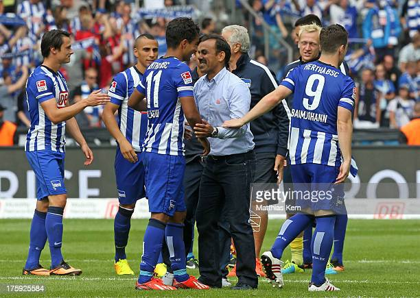 Head coach Jos Luhukay and Sami Allagui show their delight after winning the Bundesliga match between Hertha BSC Berlin and Eintracht Frankfurt at...