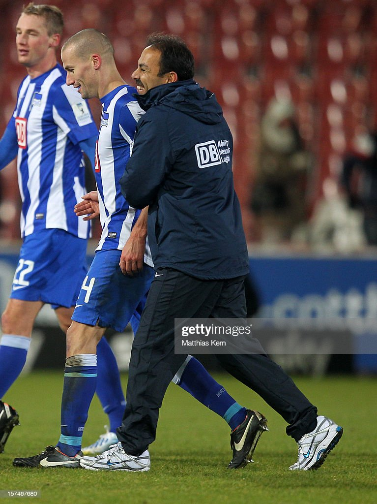 Head coach Jos Luhukay (R) of Berlin and Peer Kluge (L) show their delight after winning the Second Bundesliga match between FC Energie Cottbus and Hertha BSC Berlin at Stadion der Freundschaft on December 3, 2012 in Cottbus, Germany.
