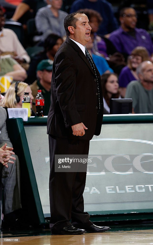 Head coach Jose Fernandez of the South Florida Bulls directs his team against the Florida A&M Rattlers during the game at the Sun Dome on December 29, 2012 in Tampa, Florida.