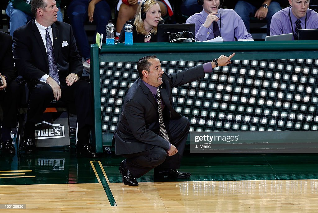 Head coach Jose Fernandez of the South Florida Bulls directs his team against the Marquette Golden Eagles during the game at the Sun Dome on January 26, 2013 in Tampa, Florida.