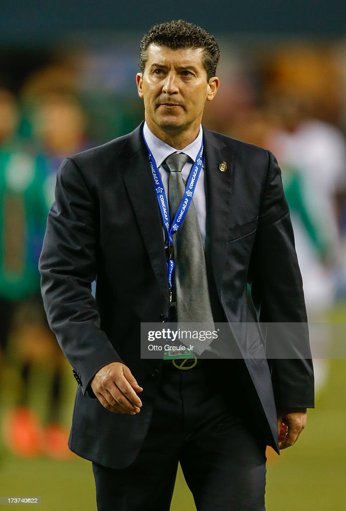 Head coach <a gi-track='captionPersonalityLinkClicked' href=/galleries/search?phrase=Jose+Manuel+de+la+Torre&family=editorial&specificpeople=884919 ng-click='$event.stopPropagation()'>Jose Manuel de la Torre</a> of Mexico walks off the pitch after the match against Canada at CenturyLink Field on July 11, 2013 in Seattle, Washington.