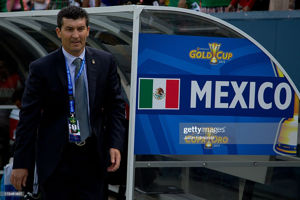 Head Coach Jose Manuel de la Torre of Mexico walks on the field before a CONCACAF Gold Cup match against Martinique at Sports Authority Field at Mile High on July 14, 2013 in Denver, Colorado.