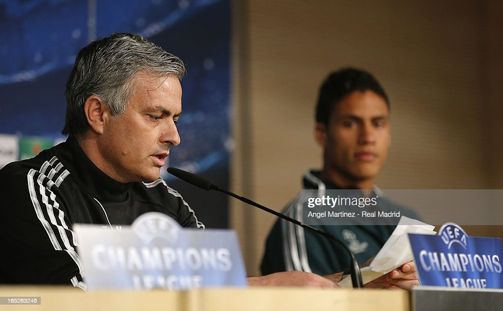 Head coach Jose Mourinho (L) and <a gi-track='captionPersonalityLinkClicked' href=/galleries/search?phrase=Raphael+Varane&family=editorial&specificpeople=7365948 ng-click='$event.stopPropagation()'>Raphael Varane</a> of Real Madrid attend a press conference ahead of their UEFA Champions League quarter-final first leg match against Galatasaray AS at the Valdebebas training ground on April 2, 2013 in Madrid, Spain.