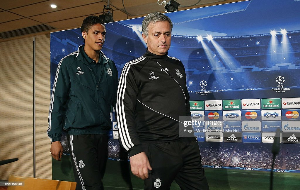 Head coach Jose Mourinho (R) and <a gi-track='captionPersonalityLinkClicked' href=/galleries/search?phrase=Raphael+Varane&family=editorial&specificpeople=7365948 ng-click='$event.stopPropagation()'>Raphael Varane</a> of Real Madrid attend a press conference ahead of their UEFA Champions League quarter-final first leg match against Galatasaray AS at the Valdebebas training ground on April 2, 2013 in Madrid, Spain.
