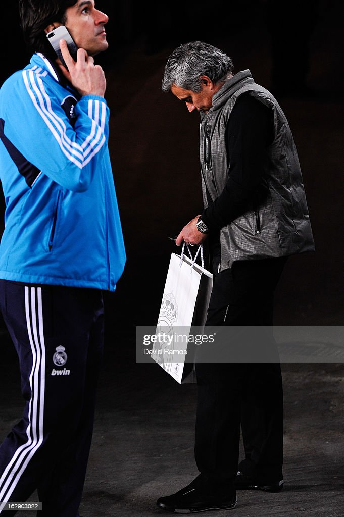 Head Coach Jose Mourinho (R) checks his mobile phone as his assitant <a gi-track='captionPersonalityLinkClicked' href=/galleries/search?phrase=Aitor+Karanka&family=editorial&specificpeople=601579 ng-click='$event.stopPropagation()'>Aitor Karanka</a> of Real Madrid CF talks on his mobile phone at the end of the Copa del Rey Semi Final second leg between FC Barcelona and Real Madrid at Camp Nou on February 26, 2013 in Barcelona, Spain.