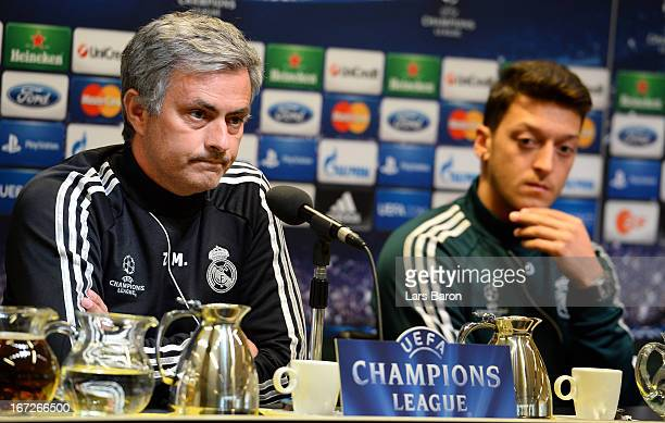 Head coach Jose Mourinho looks on next to Mesut Oezil during a Real Madrid press conference ahead of their UEFA Champions League Semi Final first leg...