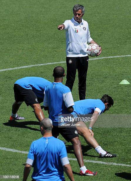 Head coach Jose Mourinho of Inter Milan gives instructions to his players during a training session at the Valdebebas training ground ahead of their...