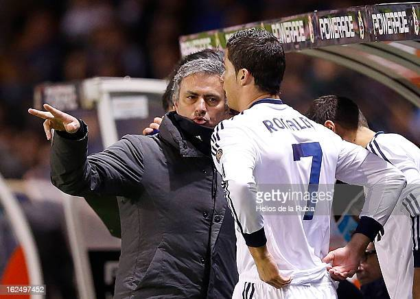 Head coach Jose Mourinho of Real Madrid and Cristiano Ronaldo give game instructions during the La Liga match between Deportivo La Coruna and Real...