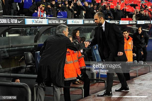 Head coach Jose Mourinho of Real Madrid and head coach Josep Guardiola of Barcelona shake hands prior to the La Liga match between Barcelona and Real...