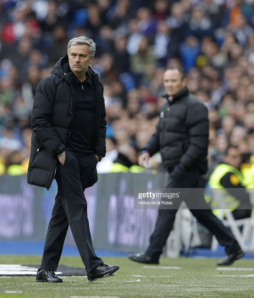Head coach Jose Mourinho (L) of Real Madrid C.F gestures during the La Liga match between Real Madrid and Levante at Estadio Santiago Bernabeu on April 6, 2013 in Madrid, Spain.