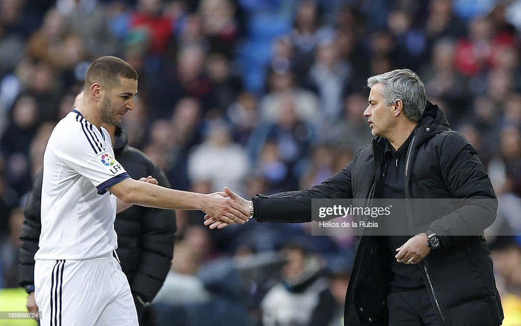 Head coach Jose Mourinho (R) of Real Madrid C.F greets Karim Benzema during the La Liga match between Real Madrid and Levante at Estadio Santiago Bernabeu on April 6, 2013 in Madrid, Spain.