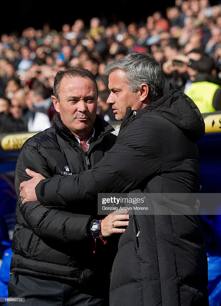 head coach Jose Mourinho (R) of Real Madrid CF hugs head coach Juan Ignacio Martinez (L) of Levante UD prior to start the La Liga match between Real Madrid CF and Levante UD at Santiago Bernabeu Stadium on April 6, 2013 in Madrid, Spain.