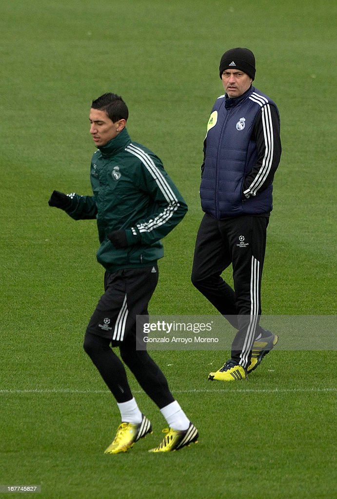 Head coach Jose Mourinho of Real Madrid CF watches Angel Di Maria during a training session ahead of the UEFA Champions League Semifinal second leg match between Real Madrid and Borussia Dortmund at the Valdebebas training ground on April 29, 2013 in Madrid, Spain.