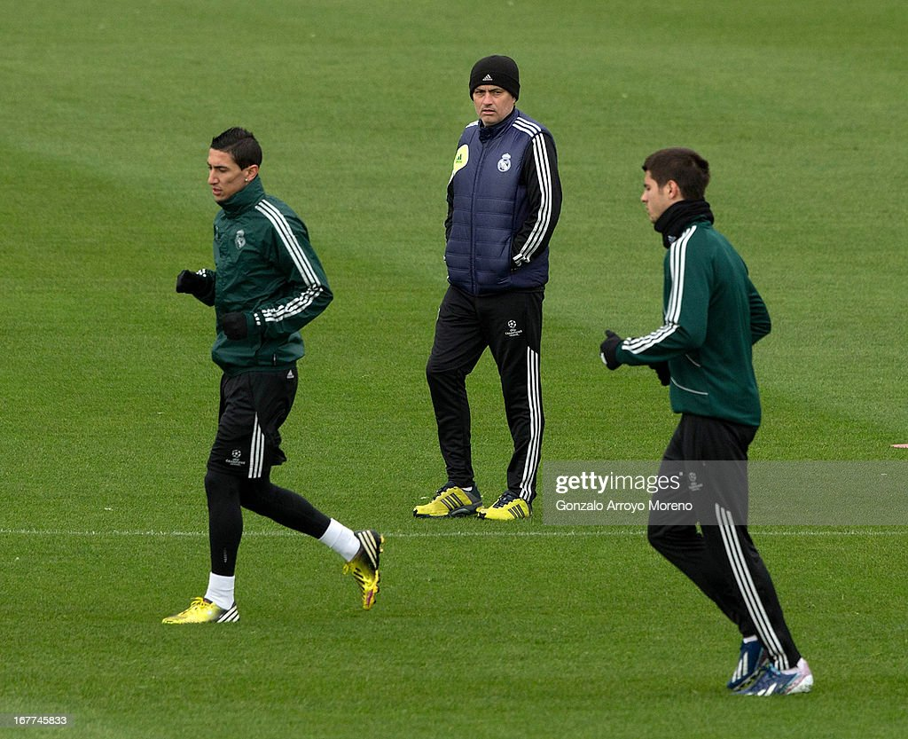 Head coach Jose Mourinho of Real Madrid CF watches Angel Di Maria (L) and Alvaro B. Morata (R) during a training session ahead of the UEFA Champions League Semifinal second leg match between Real Madrid and Borussia Dortmund at the Valdebebas training ground on April 29, 2013 in Madrid, Spain.