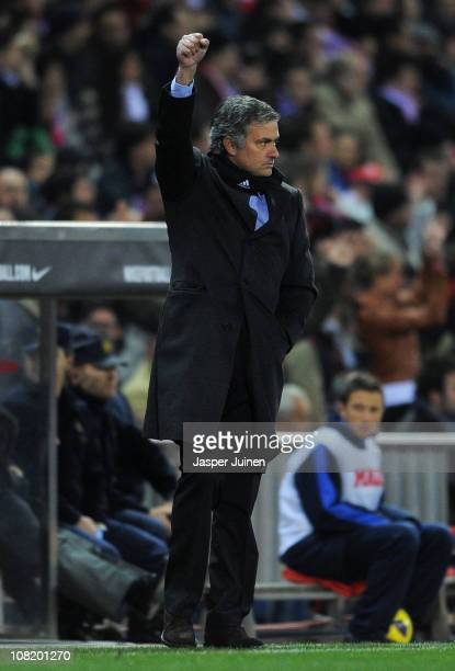 Head coach Jose Mourinho of Real Madrid clenches his fist as he celebrates after his side scored the opening goal during the quarterfinal Copa del...