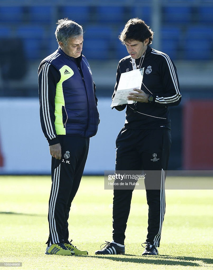 Head coach Jose Mourinho (L) of Real Madrid confers with his assistant Aitor Karanka during a training session ahead of their UEFA Champions League group stage match against Borussia Dortmund at Valdebebas training ground on November 5, 2012 in Madrid, Spain.