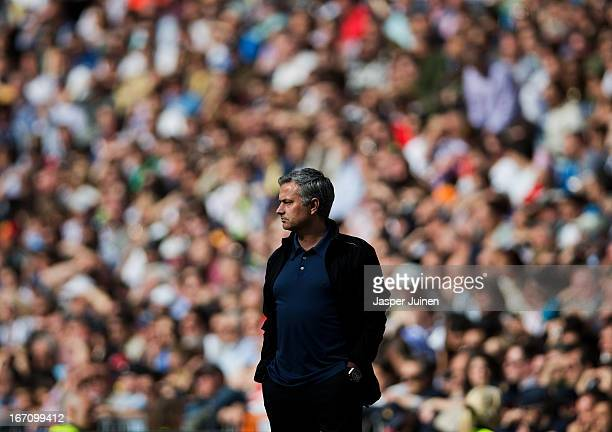 Head coach Jose Mourinho of Real Madrid follows the game during the la Liga match between Real Madrid CF and Real Betis Balompie at Estadio Santiago...