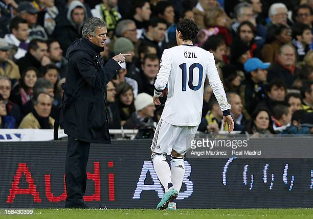 Head coach Jose Mourinho of Real Madrid gives instructions to Mesut Ozil during the La Liga match between Real Madrid and RCD Espanyol at Santiago...